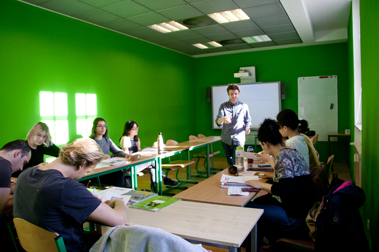 B2 exam Berlin; students in a classroom writing an exam