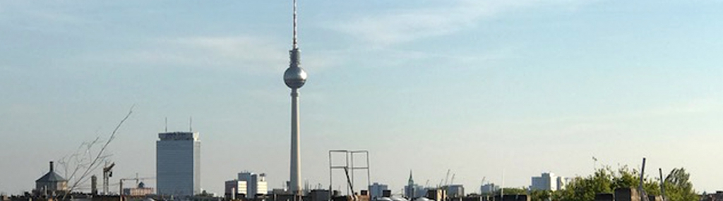 Learn German Berlin; the sky over Berlin and the Alexanderplatz