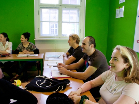 Learn German B2 Berlin; students sitting in class